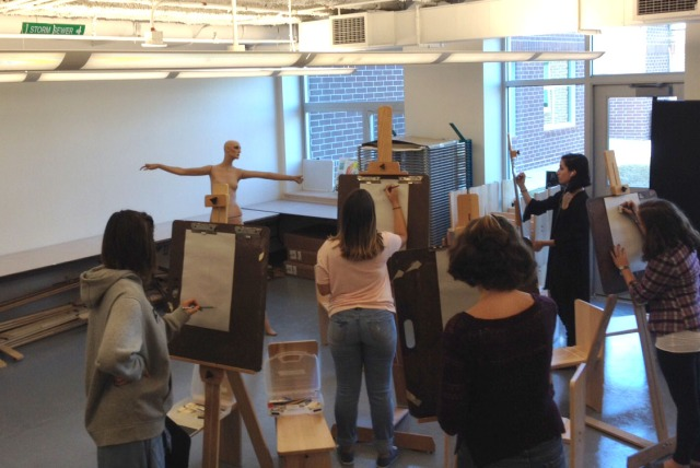 Anatomy and Figure Drawing students keenly studying their class mannequin.